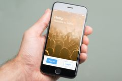 Hand Holding Apple iPhone6 With Twitter Home Screen Royalty Free Stock Images