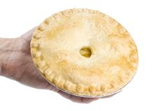Hand Holding an Apple Pie Royalty Free Stock Image