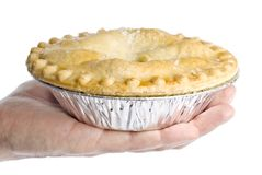 Hand Holding an Apple Pie Stock Image