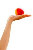Hand holding an apple Stock Photos