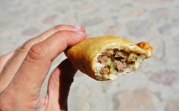 Hand holding an argentinean empanada Royalty Free Stock Photography
