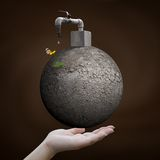Hand holding arid world with faucet Royalty Free Stock Photo