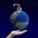 Hand holding arid world with faucetarid world with faucet Royalty Free Stock Photography