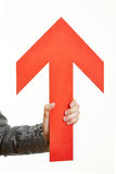 Hand holding arrow pointing up Stock Image