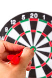 Hand Holding Arrow and Throwing Dart Board Royalty Free Stock Photography