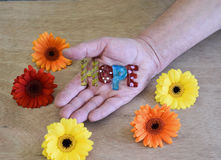 Hand holding art glass peice spelling hope Stock Photos