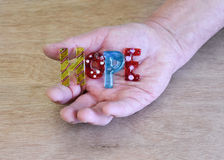 Hand holding art glass peice spelling hope Stock Photo