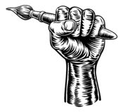 Hand Holding Artists Paintbrush. A fist hand holding an artists paintbrush in a vintage intaglio woodcut engraved or retro propaganda style royalty free illustration