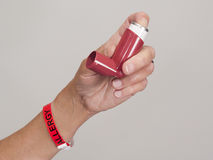 Hand holding asthma inhaler Royalty Free Stock Photography
