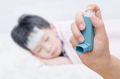 Hand holding asthma inhaler Stock Photo