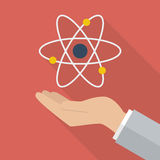 Hand holding atom symbol Stock Images