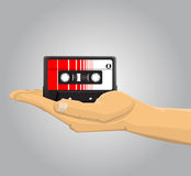 Hand holding an audio casette Stock Photos