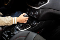 Hand holding automatic transmission in car Royalty Free Stock Photo
