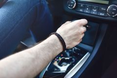 Hand Holding Automatic Transmission In Car stock photography