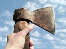 Hand holding an axe royalty free stock photos
