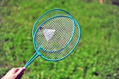 Hand holding badminton rackets Stock Photography