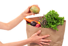 Hand holding bag full of fresh food items Royalty Free Stock Photography