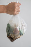Hand holding bag of garbage waste Stock Images