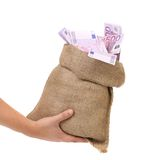 Hand holding bag with many banknotes Stock Images