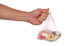 Hand holding bag of sweets Stock Photos