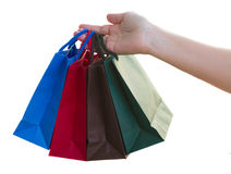 Hand holding bags Royalty Free Stock Images
