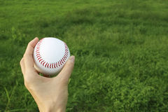 Hand holding the ball Stock Images