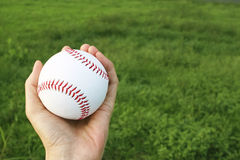 Hand holding the ball Royalty Free Stock Images