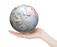 Hand holding a ball made of different banknotes, isolated Stock Photography