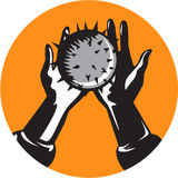 Hand Holding Ball with Spikes Circle Woodcut Stock Photo