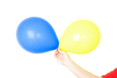 Hand holding balloons isolated on white Royalty Free Stock Photography