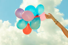 Hand holding balloons sky background Royalty Free Stock Photos