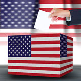 Hand holding ballot and box Stock Photography