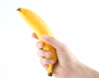 Hand holding banana Stock Images