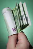 Hand holding bank notes Stock Images