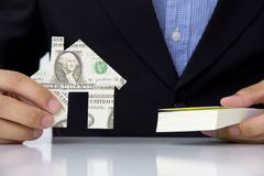 Hand holding banknote house icon Stock Photo