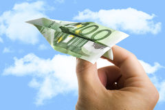 Hand Holding Banknote Paper Plane in making money and financial Stock Image