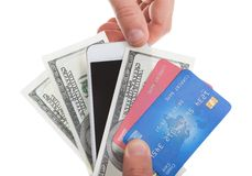 Hand holding banknotes credit cards and a tablet Stock Photo