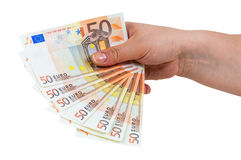 Hand holding banknotes of 50 euro. Isolated on white background with clipping path Stock Photos