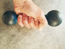 Hand holding barbell Royalty Free Stock Photography