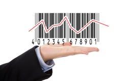 Hand holding barcode illustrating the stock market stock image