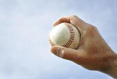 Hand holding a baseball Stock Photos