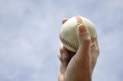 Hand holding a baseball Stock Photo