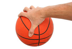 Hand holding a basketball ball isolated Royalty Free Stock Photos