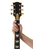 Hand holding a bass guitar neck. Isolated stock images