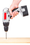 Hand holding battery drill Stock Images