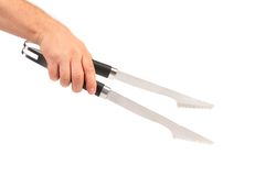 Hand holding bbq tongs. Stock Image