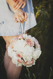 Hand holding a beautiful bouquet Stock Photo