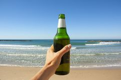 Bottle of beer on the background of the sea royalty free stock photos
