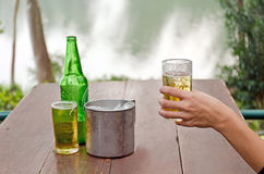 Hand holding beer glass Stock Images