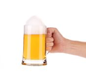 Hand holding beer glass. Isolated on a white background Royalty Free Stock Image